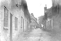 BNPS.co.uk (01202 558833)<br /> Pic: ShaftesburyHistoricalSociety/BNPS<br /> <br /> Pictured: Coppice Street in Shaftesbury at the turn of the 20th century<br /> <br /> These charming photos reveal everyday life at the turn of the 20th century in a thriving market town later made famous by a TV advert.<br /> <br /> The black and white snapshots of Shaftesbury, Dorset, were taken by Albert Tyler who set up a photography business there in 1901.<br /> <br /> There are various street scenes and also images of the locals in traditional attire, with men in flatcaps and women in bonnets.<br /> <br /> Tyler photographed the busy opening of the town market in 1902, and a garden party where men played croquet.