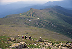Hikers leaving the summit of Mt Washington, White Mountains National Forest, New Hampshire, USA