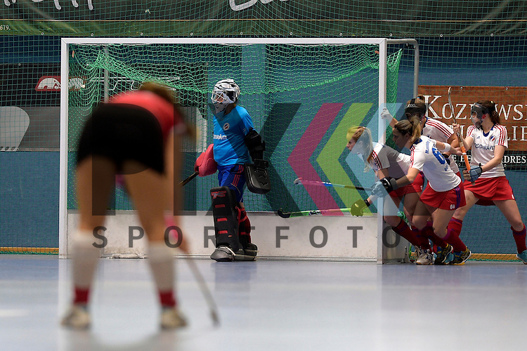 GER - Mannheim, Germany, January 10: During the 1. Bundesliga Sued Damen indoor hockey match between TSV Mannheim (red) and Mannheimer HC (white) on January 10, 2016 at TSV Mannheim in Mannheim, Germany. <br /> <br /> Foto &copy; PIX-Sportfotos *** Foto ist honorarpflichtig! *** Auf Anfrage in hoeherer Qualitaet/Aufloesung. Belegexemplar erbeten. Veroeffentlichung ausschliesslich fuer journalistisch-publizistische Zwecke. For editorial use only.