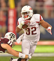 STAFF PHOTO BEN GOFF  @NWABenGoff -- 09/27/14 Arkansas running back Jonathan Williams attempts to break the tackle of Texas A&M free safety Clay Honeycutt during the fourth quarter of the Southwest Classic at AT&T Stadium in Arlington, Texas on Saturday September 27, 2014.