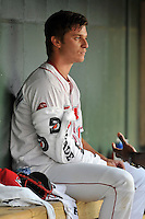 Starting pitcher Marc Brakeman (12) of the Greenville Drive waits in the dugout between innings in a game against the Augusta GreenJackets on Wednesday, May 4, 2016, at Fluor Field at the West End in Greenville, South Carolina. Greenville won, 6-3. (Tom Priddy/Four Seam Images)