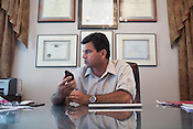 """DEVINE, TX - SEPTEMBER 26, 2013: Attorney Tomas """"Tommy"""" Ramirez speaks on the phone to opposing counsel in his office in Devine, Texas. Mr. Ramirez represents the Cerny family of Karnes County, Texas. CREDIT: Lance Rosenfield/Prime"""