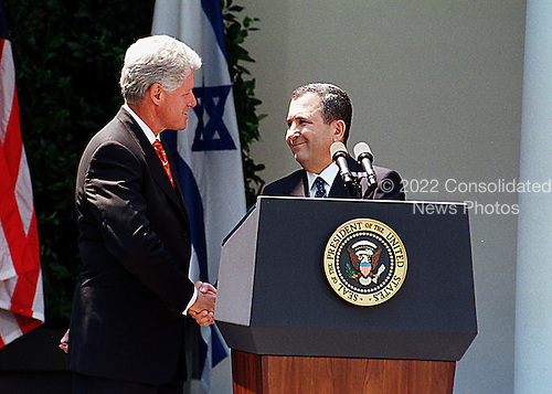 Washington, DC - July 15, 1999 -- United States President Bill Clinton shakes hands with new Prime Minister Ehud Barak of Israel at a press availability in the Rose Garden at the White House on Thursday, 15 July, 1999..Credit: Ron Sachs / CNP