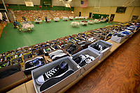 NWA Democrat-Gazette/ANDY SHUPE<br /> Hundreds of shoes line the gymnasium Saturday, Aug. 10, 2019, during the River Valley Kick Start at Alma Middle School. Inspired by her daughter, Harper, attorney Carrie Jernigan bought all 1,500 pairs of shoes from a closing Payless Shoe Source in Fort Smith. Her effort national publicity and thousands of dollars in donations, which she used to buy more shoes and school supplies for kids going back to school.