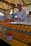 Man making fresh orange juice, Marrakech, Morocco