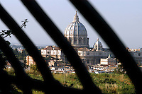 Roma, Basilica di San Pietro.Veduta tra le sbarre. Dome of St Peter's Basilica in Vatican City.A view of the Dome  through the bars