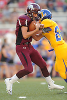 STAFF PHOTO ANDY SHUPE - Lincoln quarterback Harrison Swayne, left, is sacked by Hot Springs Lakeside defensive back Tucker Pratt during the first half of play Monday, Sept. 1, 2014, at Razorback Stadium in Fayetteville.