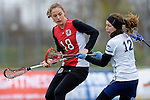 GER - Mainz, Germany, March 20: During the 1. Bundesliga Damen lacrosse match between Mainz Musketeers (white) and SC Frankfurt 1880 (red) on March 20, 2016 at Sportgelaende Dalheimer Weg in Mainz, Germany. Final score 7-12 (HT 3-5). (Photo by Dirk Markgraf / www.265-images.com) *** Local caption *** Lilly Haus #18 of SC Frankfurt 1880, Jara Koenig #12 of Mainz Musketeers