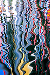 Colorful vertical line pattern reflected in water