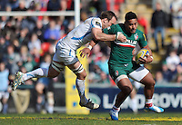 Manu Tuilagi is tackled in possession. Aviva Premiership match, between Leicester Tigers and Exeter Chiefs on March 23, 2014 at Welford Road in Leicester, England. Photo by: Patrick Khachfe / JMP