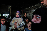 Civilians take shelter inside a welding shop after a regime fighter jet dropped bombs on several targets including a Free Syria Army run bread shop in the heart of Aleppo. After dropping four bombs (which killed 7 civilians in an apartment building including a man who burned to death inside his vehicle), the jet emptied its 50 caliber machine gun before leaving the area. September 20, 2012...© Javier Manzano