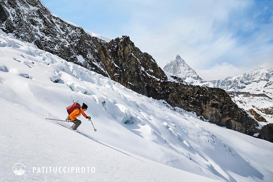 Glacier skiing while on the Schwarztor tour from Zermatt, Switzerland. In the distance is the Matterhorn.