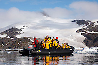 "Passengers of the Quark ship ""Sea Spirit"" enjoy a zodiac excursion in Cierva Cove on the Antarctic Peninsula."