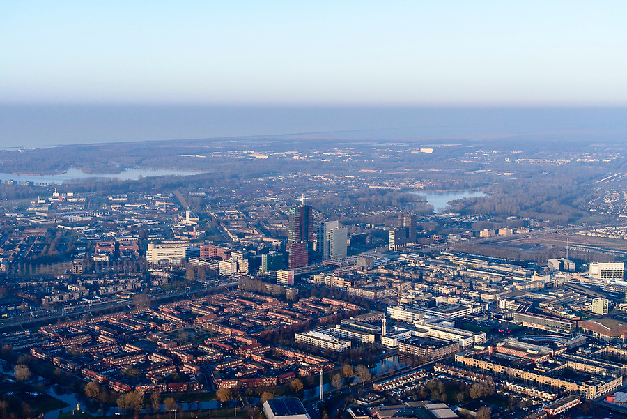 Nederland, Flevoland, Almere, 14-02-2017;  Almere-Stad, winters stadsgezicht, stadshart bij zinsondergang. Noorderplassen en IJsselmeer in de achtergrond<br /> Almere City, winter cityscape, city heart.<br />  <br /> luchtfoto (toeslag op standard tarieven);<br /> aerial photo (additional fee required);<br /> copyright foto/photo Siebe Swart