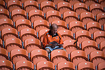 A home fans chooses to read the programme rather than watching the second-half in the near-deserted home stands at Bloomfield Road stadium as Blackpool hosted Portsmouth in an English League One fixture. The match was proceeded by a protest by around 500 home fans against the club's controversial owners Owen Oyston, many of whom did not attend the game. The match was won by the visitors by 2-1 with two goals by Ronan Curtis watched by just 4,154 almost half of which were Portsmouth supporters.