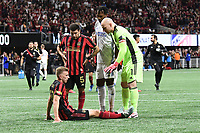 ATLANTA, GA - MARCH 07: ATLANTA, GA - MARCH 07: Atlanta United goalkeeper Brad Guzan directs injured defender Laurence Wyke to stay down during the match against FC Cincinnati, which Atlanta won, 2-1, in front of a crowd of 69,301 at Mercedes-Benz Stadium during a game between FC Cincinnati and Atlanta United FC at Mercedes-Benz Stadium on March 07, 2020 in Atlanta, Georgia.