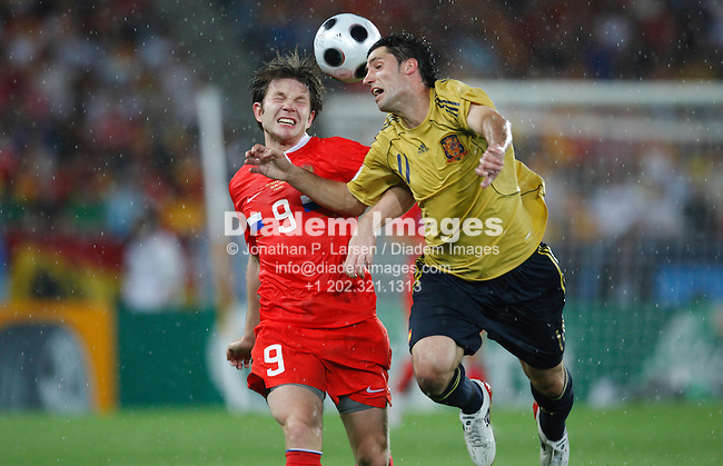 VIENNA - JUNE 26:  Ivan Saenko of Russia (l) and Joan Capdevila of Spain vie for a header during a UEFA Euro 2008 semi-final match June 26, 2008 at Ernst Happel Stadion in Vienna, Austria.  Editorial use only.  Commercial use prohibited.  (Photograph by Jonathan Paul Larsen)
