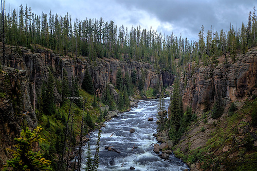 The Lewis River winds its way throughLweis Canyon at Yellowstone National Park, Wyoming