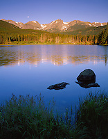 Rocky Mountain National Park, CO<br /> Setting moon over Otis Peak, Hallett Peak, and Flattop Mountain with  reflections on Sprague Lake