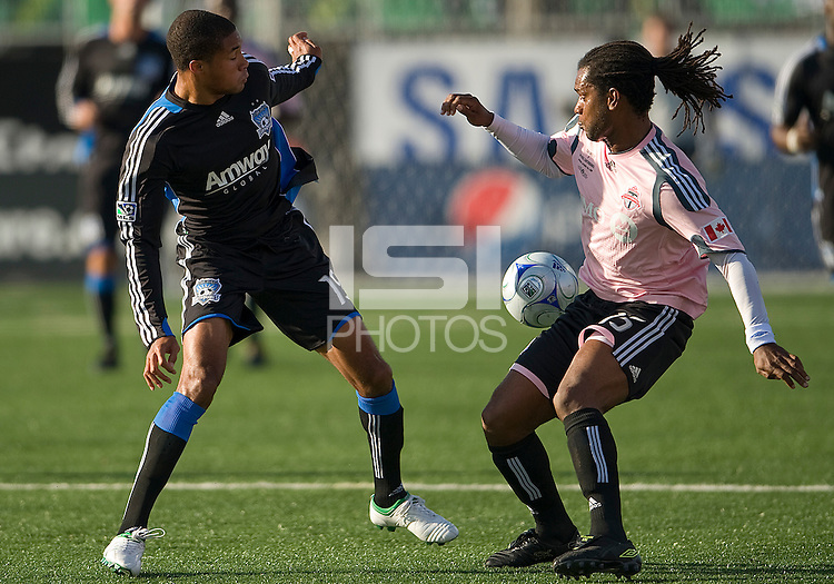 10 October 2009: San Jose Earthquakes forward Ryan Johnson #19 and Toronto FC defender Adrian Serioux #15 in action during MLS action between Toronto FC and San Jose Earthquakes at BMO Field in Toronto..The final score was 1-1..
