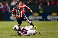 CD Chivas USA defender Ben Zemanski (21) intercepts the ball from Colorado Rapids midfielder Jamie Smith (20). The Colorado Rapids defeated CD Chivas USA 1-0 at Home Depot Center stadium in Carson, California on Saturday March 26, 2011...