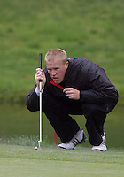 20 May, 2010:  Loyola Universities Jason Burton looks over his shot on hole nine of the NCAA Division I Regionals tournament Thursday at Gold Mountain Golf Course in Bremerton, WA.