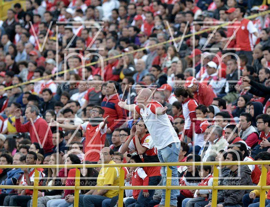 BOGOTÁ -COLOMBIA, 22-03-2014. Aspecto de los hinchas de Santa Fe durante el encuentro entre Independiente Santa Fe y Boyacá Chico FC por la fecha 12 de la Liga Postobón  I 2014 disputado en el estadio Nemesio Camacho El Campín de la ciudad de Bogotá./ Aspect of the fans of Santa Fe during the match between Independiente Santa Fe and Boyaca Chico FC for the 12th date of the Postobon  League I 2014 played at Nemesio Camacho El Campin stadium in Bogotá city. Photo: VizzorImage/ Gabriel Aponte / Staff