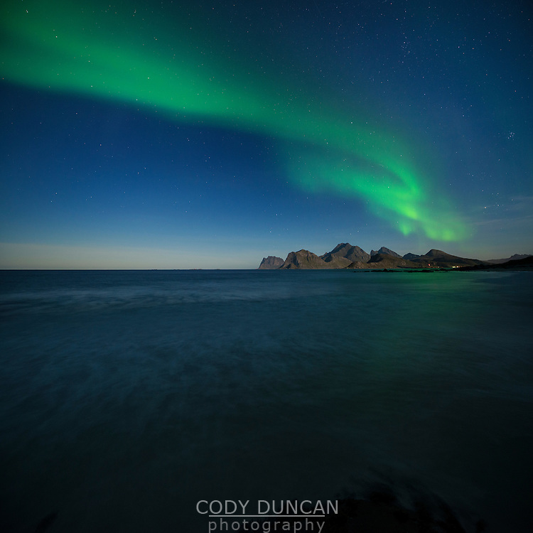 Northern lights in sky over Storsandnes beach, Flakstadøy, Lofoten Islands, Norway