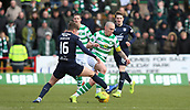 17th March 2019, Dens Park, Dundee, Scotland; Ladbrokes Premiership football, Dundee versus Celtic; Ethan Robson of Dundee  tackles Scott Brown of Celtic