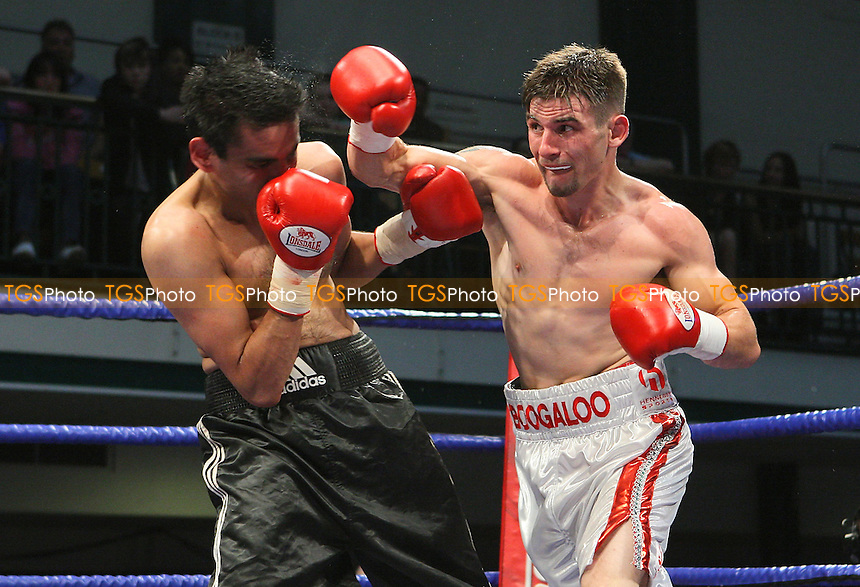 Bobby Ward (Nazeing, white shorts) defeats Sid Razak (Birmingham, black shorts) in a Lightweight Boxing contest at York Hall, Bethnal Green, promoted by Hennessy Sports - 18/07/09 - MANDATORY CREDIT: Gavin Ellis/TGSPHOTO - Self billing applies where appropriate - Tel: 0845 094 6026