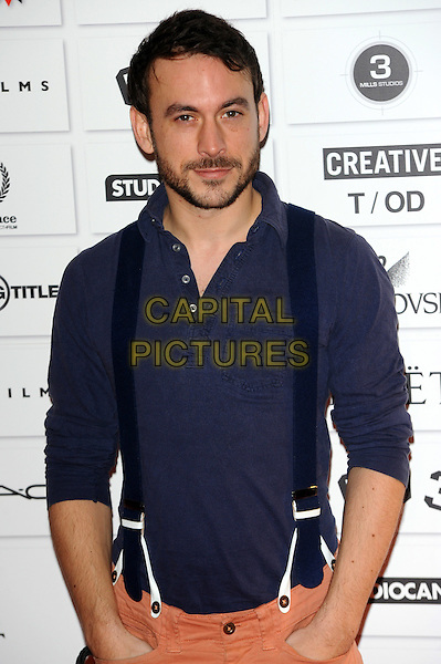 Chris New.The 14th Moet British Independent Film Awards 2011, Old Billingsgate, London, England..December 4th, 2011.half length black suspenders braces hands in pockets blue purple shirt  beard facial hair.CAP/CJ.©Chris Joseph/Capital Pictures.