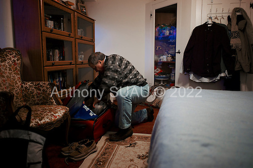 Selllersville, Pennsylvania<br /> March 24, 2011<br /> <br /> Sorting through his one suitcase of belongings and a few clothes hang on the wall, 99er Steve Nathan, a 51 year old paralegal, was evicted from his home of 11 years in November 2010 and lost his benefits in late 2010. He now lives in one room of a friend's home. His landlords are Darwin Roseberry and Barbara Wise a 70 year old married couple who live on a farm and practice law.