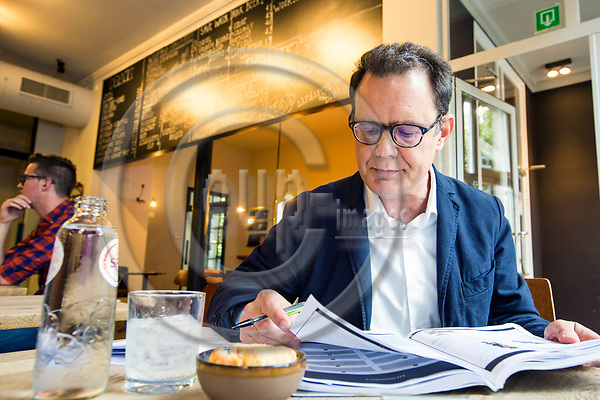 BRUSSELS - BELGIUM - 21 August 2017 -- British EU-Correspondent for the New York Times, James KANTER, wants to change his nationality to the Belgium one because of Brexit. He has to study and learn to speak Flemish for the integration test he has to undergo. Practising his Flemish in the cafe Markten. -- PHOTO: Juha ROININEN / EUP-IMAGES