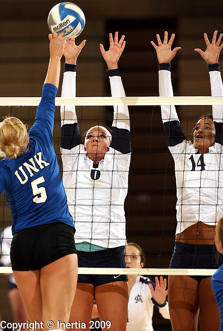 SIOUX FALLS, SD - SEPTEMBER 2:  Breanna Brandt #6 and Blythe Johnson #14 of Augustana double team for a block on Erica Burson #5 of Nebraska-Kearney in the second game of their match Wednesday night at the Elmen Center. (Photo by Dave Eggen/Inertia).