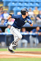 Columbia Fireflies left fielder Matt Winaker (5) runs to first base during a game against the Asheville Tourists at McCormick Field on August 3, 2018 in Asheville, North Carolina. The Fireflies defeated the Tourists 6-3. (Tony Farlow/Four Seam Images)