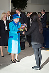 © Joel Goodman - 07973 332324 . No syndication permitted . 14/11/2013 . Manchester , UK . The Queen is presented with a bunch of flowers . Queen Elizabeth II and the Duke of Edinburgh visit the Coop building at 1 Angel Square , Manchester , this morning ( 14th November 2013 ) . Photo credit : Joel Goodman