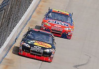 Jun 1, 2008; Dover, DE, USA; NASCAR Sprint Cup Series driver Martin Truex Jr (1) leads Jeff Gordon (24) during the Best Buy 400 at the Dover International Speedway. Mandatory Credit: Mark J. Rebilas-US PRESSWIRE