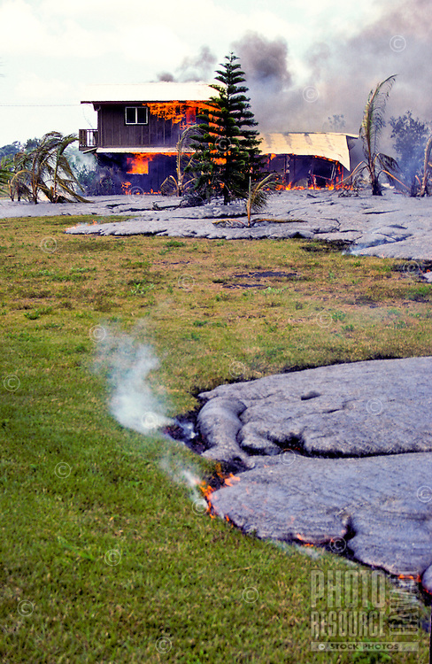 Lava surrounds and burns down a house in Kalapana on the Big Island of Hawaii