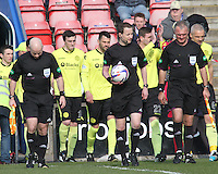Referee William Collum leads the teams onto the park with Assistant Referee Martin Cryans (left) and Assistant Referee Willie Conquer in the Inverness Caledonian Thistle v St Mirren Scottish Professional Football League Premiership match played at the Tulloch Caledonian Stadium, Inverness on 29.3.14.
