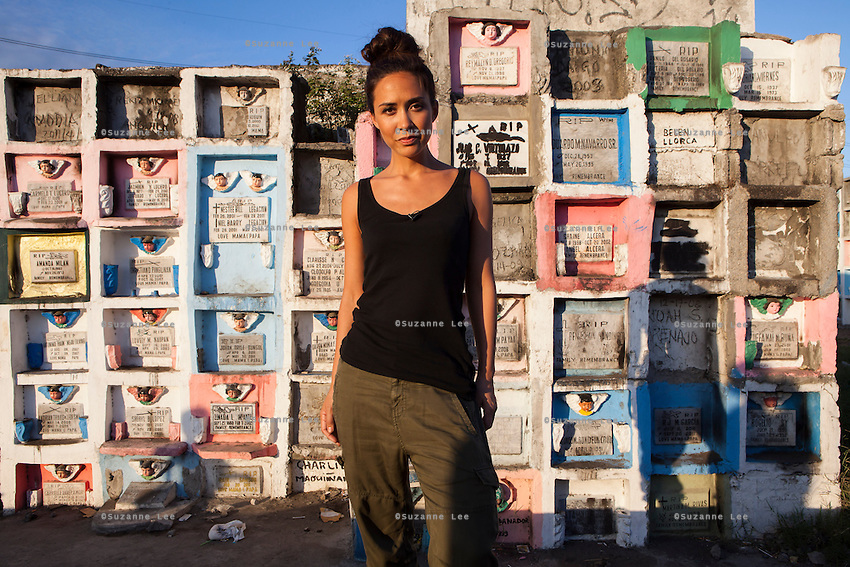 UK celebrity Myleene Klass poses for a portrait in a graveyard where she has come to meet underprivileged mothers and children who live in an inhabited cemetery in Paranaque City, Metro Manila, The Philippines on 18 January 2013. Photo by Suzanne Lee for Save the Children UK