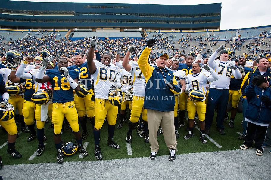 Michigan head coach Rich Rodriguez, front, leads his team in singing the school fight song after the Wolverines' spring football game, Saturday, April 17, 2010, at Michigan Stadium in Ann Arbor, Mich. (AP Photo/Tony Ding)