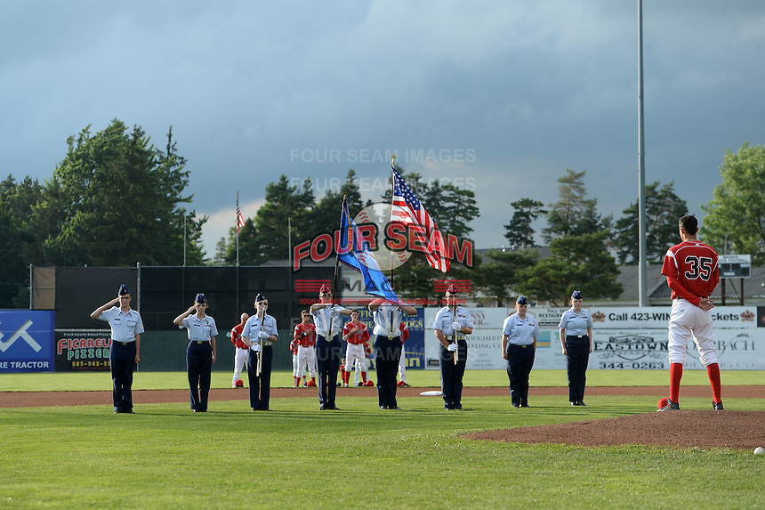 Batavia Muckdogs national anthem flag presentation before a game against the State College Spikes on July 3, 2014 at Dwyer Stadium in Batavia, New York.  State College defeated Batavia 7-1.  (Mike Janes/Four Seam Images)