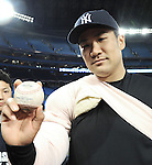 Masahiro Tanaka (Yankees),<br /> APRIL 4, 2014 - MLB :<br /> Masahiro Tanaka of the New York Yankees poses with the ball as he celebrates after the baseball game against the Toronto Blue Jays at Rogers Centre in Toronto, Ontario, Canada. Tanaka made his major league debut in the 7-3 Yankees win. (Photo by AFLO)