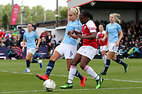 Danielle Carter of Arsenal Women and Steph Houghton of Manchester City Women during Arsenal Women vs Manchester City Women, FA Women's Super League Football at Meadow Park on 11th May 2019