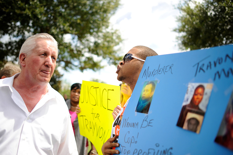 Demonstrators have a heated discussion about the guilt of George Zimmerman as they gather and wait for a verdict in Zimmerman's trial  at the Seminole County Criminal Justice Center in Sanford, Florida, USA, 13 July 2013. Zimmerman, a former volunteer neighborhood watch captain, had been charged with second-degree murder in the 26 February 2012 shooting death of 17 year-old Trayvon Martin in Sanford, Florida.