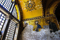 Fine Art Travel Photography. The Hagia Sophia in Istanbul Turkey is a former Orthodox patriarchal basilica that later was turned into a mosque.<br /> In 1453, Constantinople was conquered by the Ottoman Turks under Sultan Mehmed II, who subsequently ordered the building converted into a mosque.<br /> This photograph shows the stained glass window pane and The Deesis mosaic with Christ as ruler.