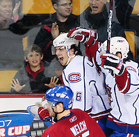 April 28, 2007; Hamilton, ON, CAN; Hamilton Bulldogs centre (26) Maxim Lapierre celebrates his third period goal with teammate right winger (19) Duncan Milroy while skating past Rochester Americans defenceman (45) Noah Welch in game six in the AHL north division semifinal at Copps Coliseum. The Bulldogs won 6-2 and eliminated the Americans from the playoffs. Mandatory Credit: Ron Scheffler, Special to the Spectator. (File number RRSA8478).