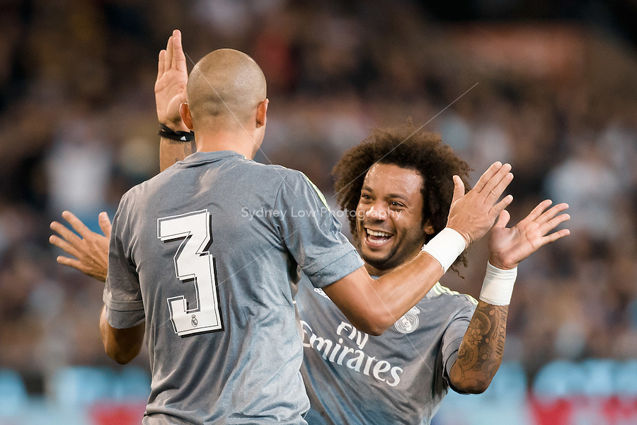 Melbourne, 24 July 2015 - Pepe of Real Madrid celebrates his goal with Marcelo Vieira in game three of the International Champions Cup match between Manchester City and Real Madrid at the Melbourne Cricket Ground, Australia. Real Madrid def City 4-1. (Photo Sydney Low / AsteriskImages.com)