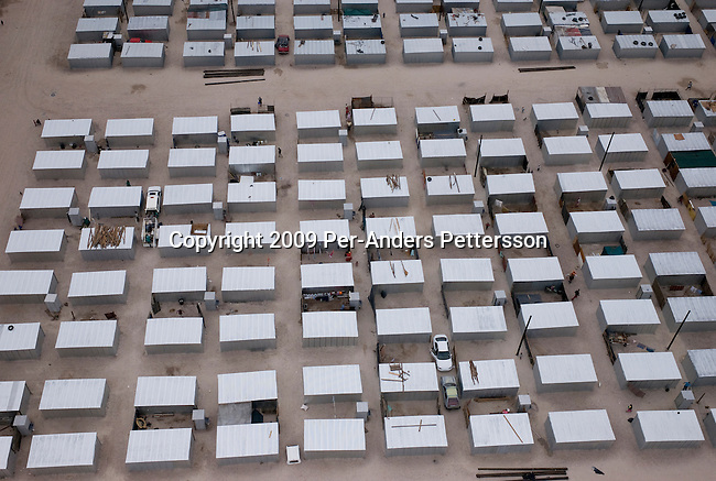 DELFT, SOUTH AFRICA MARCH 18: An aerial of subsidized housing built by the local government stands on March 18, 2009, in Delft, South Africa. Delft is one of the poorest areas in Cape Town and there are many problems between colored and black residents. They are all competing for the newly build houses. These metal shacks are placed in perfect order. South Africa is facing a severe backlog of subsidized housing despite that millions have been built since 1994. (Photo by: Per-Anders Pettersson/Getty Images)...