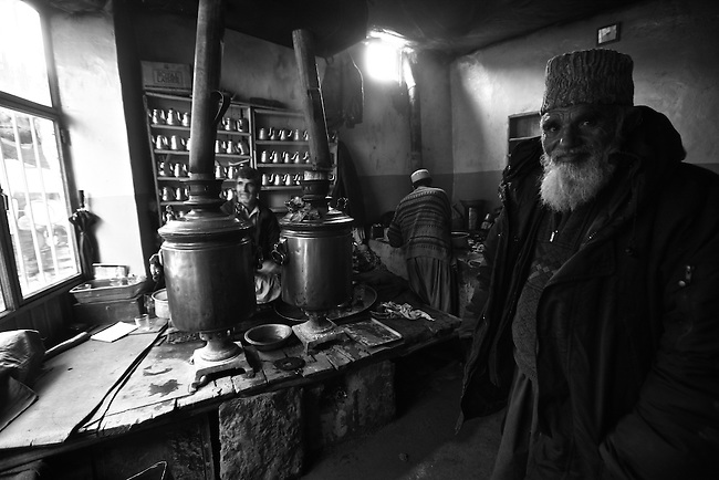 An old man stands inside a tea shop in the central market of Kabul, Afghanistan. Despite the ever-present mud and miserable winter weather, the market bustles daily with commerce of all kinds. Taliban attacks have so far been infrequent in the Afghan capital, and as life goes on at a normal pace, the war often seems far away. Feb. 3, 2009.